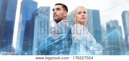 business, partnership, success and people concept - businessman and businesswoman standing over city and office buildings with charts background