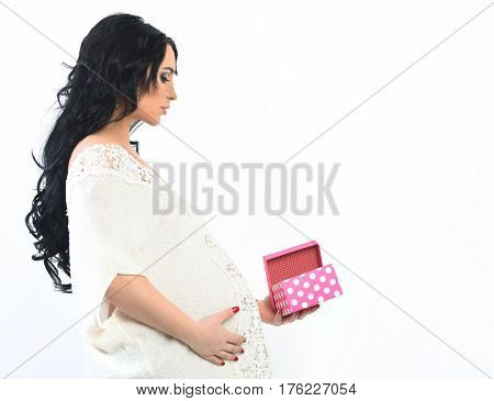 Pretty Cute Pregnant Woman Stroking Her Belly With Presebt Box