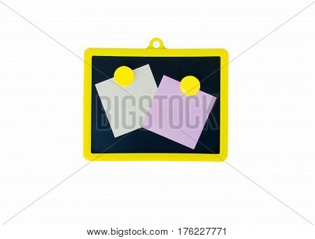 Small black magnetic board for chalk with two notes for notes on magnets on a white background