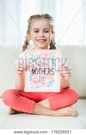 Smiling Girl Showing Happy Mother's Day Postcard In Hands, Mother's Day Concept