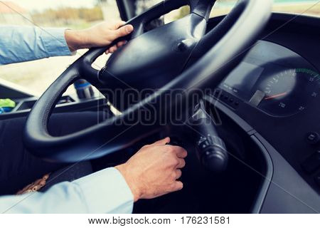 transport, transportation, tourism, road trip and people concept - close up of bus driver starting bus