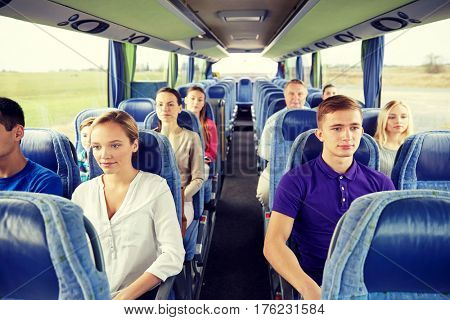 transport, tourism, road trip and people concept - group of passengers or tourists in travel bus