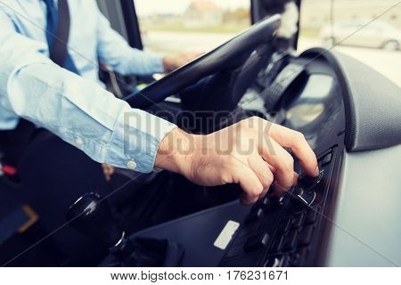 transport, transportation, tourism, road trip and people concept - close up of bus driver driving passenger bus