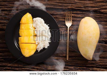 Mango Sticky Rice Still Life On Wooden Background