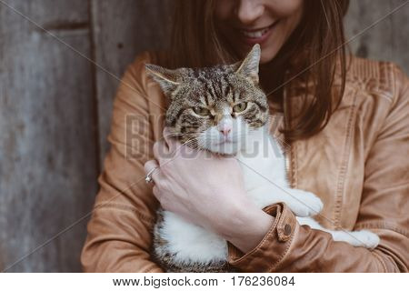 cat lying in woman hands
