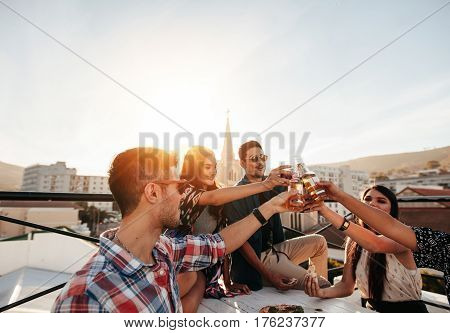 Friends Hanging Out With Drinks On Rooftop Party
