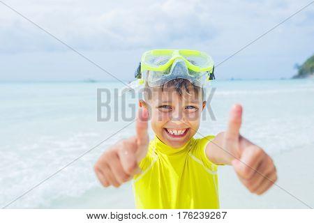 Photo of happy snorkeling boy in yellow swimwear