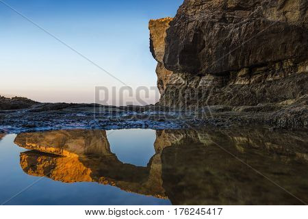 Gozo Malta - Sunriseat the beautiful Azure Window a natural arch and famous landmark on the island of Gozo with reflection. It's been collapsed on 9th of March 2017