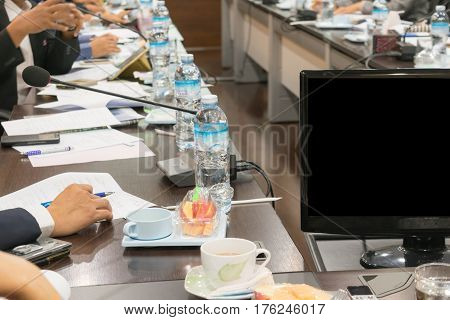 People attend business meetings in the conference room.