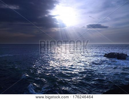 Cold, blue and calm sea under a cloudy sky