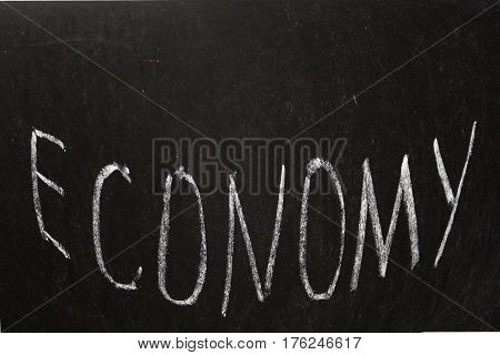 Economics Chalk Board Economy. word Economy written on blackboard
