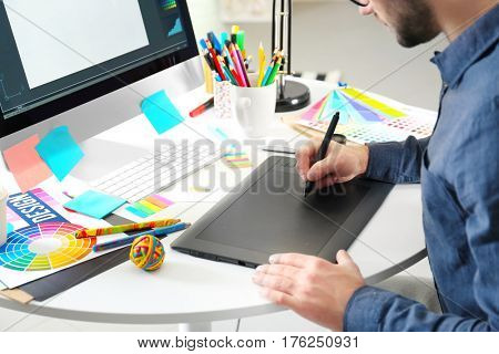 Modern designer working with graphic tablet