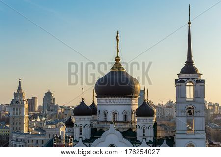 The Annunciation Cathedral in the center of Voronezh city, Russia, famous orthodox church at sunset and city buildings background, copy space