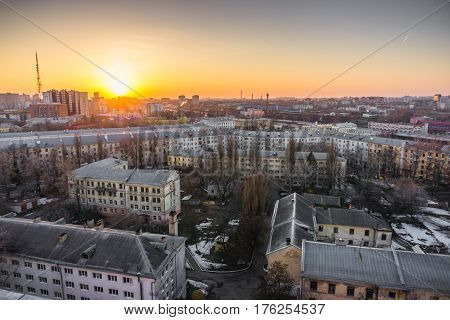 Cityscape sunset, aerial view from rooftop of Voronezh city, houses, dormitories, industrial zones and sleeping quarters