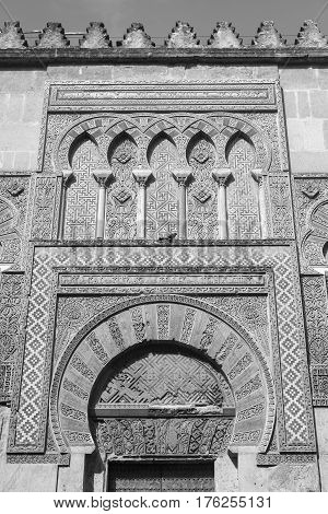 Cordoba (Andalucia Spain): door of the external walls of the medieval cathedral known as mezquita-catedral. Black and white