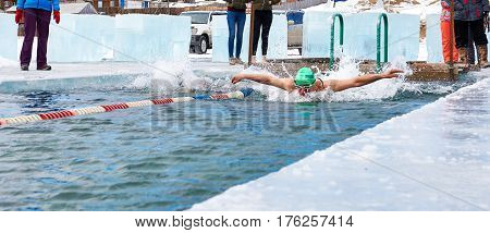Sahyurta ,, Irkutsk Region, Russia - March 11.2017: Cup Of Baikal. Winter Swimming Competitions. But