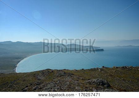 Baikal lake near Khuzhir villahe at Olkhon island in Siberia, Russia. Lake Baikal is the largest freshwater lake in the world.