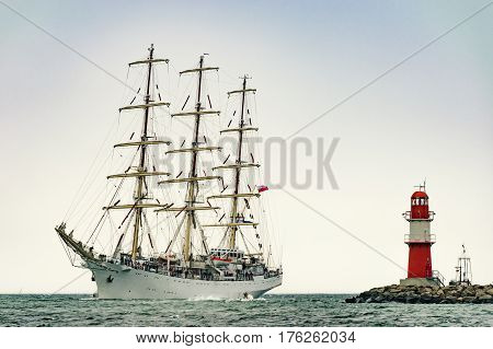 Sailing ship on the sea. Tall Ship.Yachting and Sailing travel. Cruises and holidays. Postcard and Book cover.