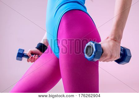 Partial View Of Sporty Woman Holding Dumbbells On Pink