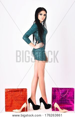 Pretty Woman With Shopping Bags, Shoes In Green Sequins Dress