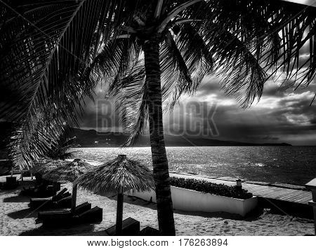Stormy skies mixed with sunshine over the beach in Montego Bay Jamaica