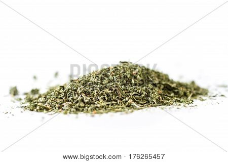 Dried savory isolated on white. Dry spices