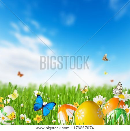 Colored decorative easter eggs in grass with blur sky background