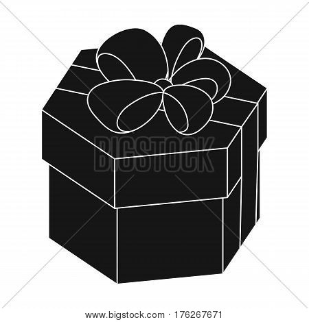 A yellow festive gift in a purple ribbon.Gifts and Certificates single icon in black style vector symbol stock web illustration.