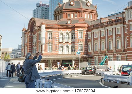 Tokyo Japan - Nov 19 2015 : Traveler is taking the photo of Tokyo station Tokyo Japan. This station is main station of train system of Tokyo.