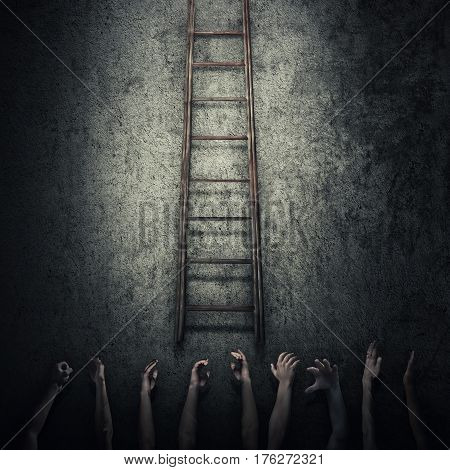 Abstract idea concept as a lot of human hands stretched out to reach a ladder and escape from a dark room prison. Surrounded by limitations danger and fear symbol.