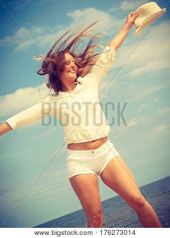 Happiness and craziness. Smiling crazy girl have fun outdoor. Young attractive woman with waving long hair playing on summer beach.