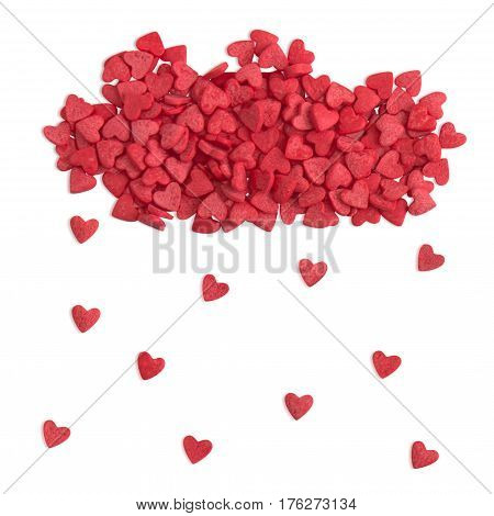 Red cloud shape and rain made of small hearts candy sprinkles over white with path