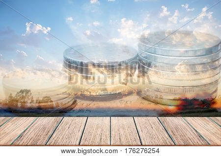Double exposure of money coins for finance and banking concept Empty wood table top perspective wood can be used for display products.