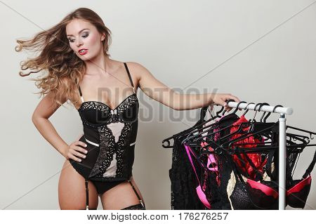 Expressive Sexy Lady With Collection Of Lingerie.