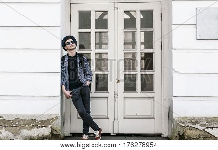 Stylish young man near the door of an old building