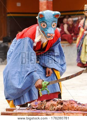 Lamayuru India - June 17 2012: Monk in mask performs sacrifice ritual on a religious masked and costumed Cham Dance Festival of Tibetan Buddhism in Lamayuru monastery India.
