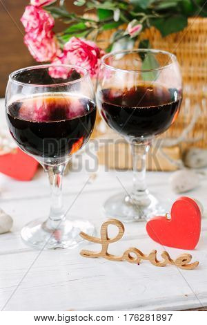 Two Wine Glasses With Heart And Letters Love