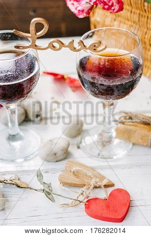 Wooden Word Love Standing On Glasses Of Wine
