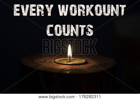 Every Workount Counts - White Candle With Dark Background - In A Wooden Candlestick