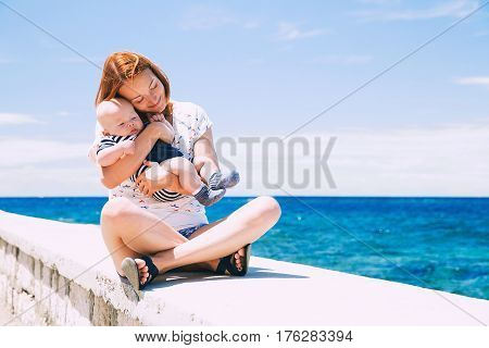 Happy Family Relaxing By The Sea.