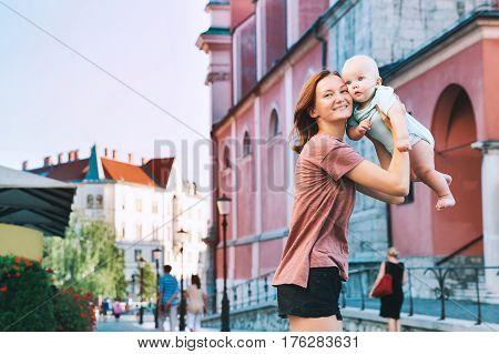 Family In Old Town Center Of Ljubljana, Slovenia.
