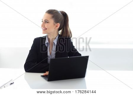 Portrait Of Smiling Business Woman With Laptop In The Office