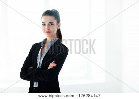 Portrait Of Young Beautiful Business Woman With Crossed Arms