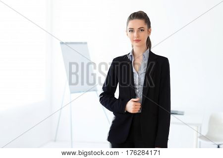 Young Beautiful Business Woman In The Office