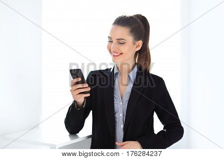 Happy Business Woman Holding Mobile Phone