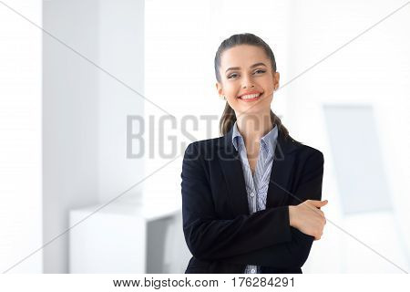 Portrait Of Young Laughing Business Woman In The Office