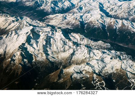 Aerial view of alps mountains covered with snow. Bird Eye View