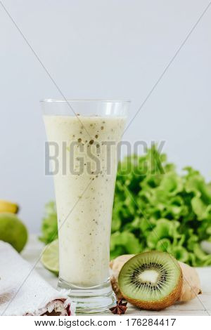Fresh Smothie - Vegan Drink With Banana, Salad Leaves, Ginger And Kiwi.