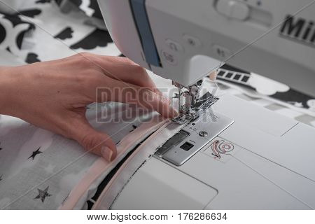 sewing machine and item of clothing close up