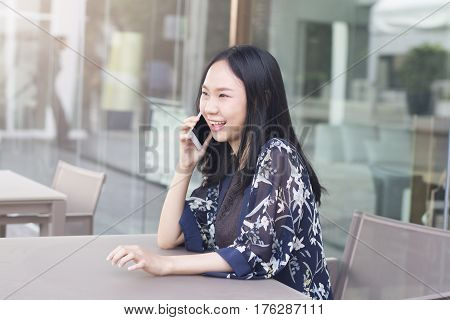 Asian Woman Is Happiness When Negotiating Successful In Business